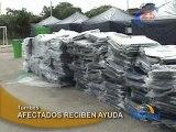 AFECTADOS RECIBEN AYUDA - TUMBES