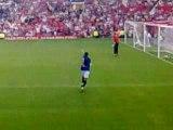 Rio Ferdinand warming up at Solskjaer's testimonial