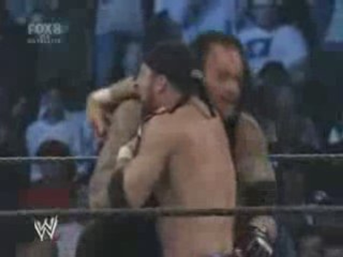 Undertaker chokeslams Gregory Helms