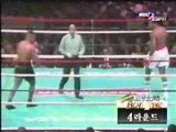 (boxe Mike Tyson vs. Larry Holmes