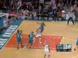 NBA Dwight Howard stuffs Nate Robinson's lay-up.