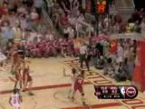 NBA Yao Ming blocks LeBron James underneath the basket which