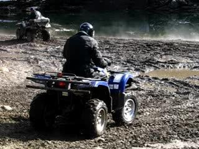quading on riverbank
