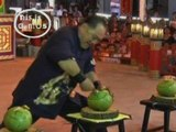 Kung-fu master breaks his finger while breaking coconuts